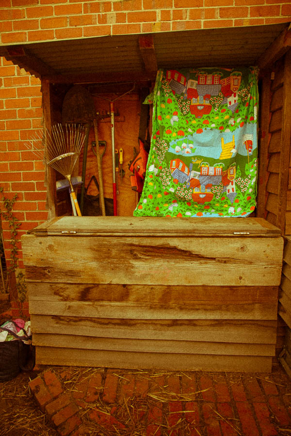 Tool area. The curtain keeps the sun away from the small bottle of methylated spirits and from the seed box.
