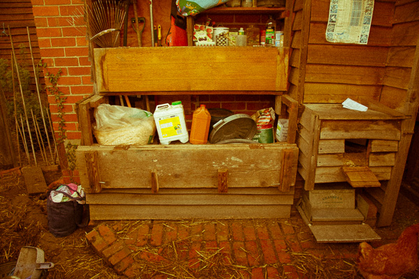 The side peels away to create access to various garden and chicken products.