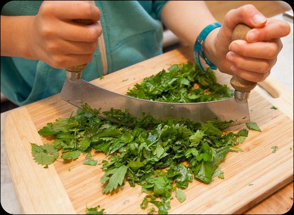 Mezza Luna knife makes cutting herbs fast.