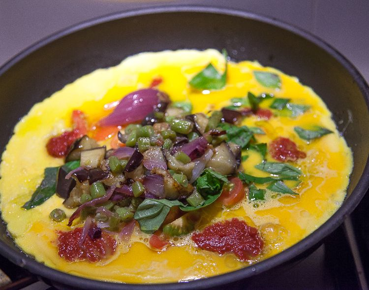 Summer meal: omelette with eggplant, french beans, red onion, basil and tomato.