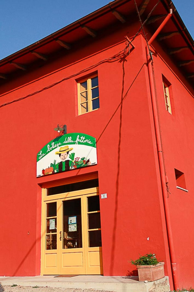 A local organic farm shop painted in the beautiful deep red colour so often seen used on Italian buildings.
