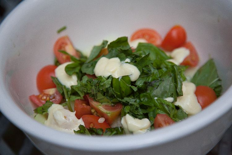 Cucumber, tomato and basil salad dressed with mayonnaise and apple cider vinegar.