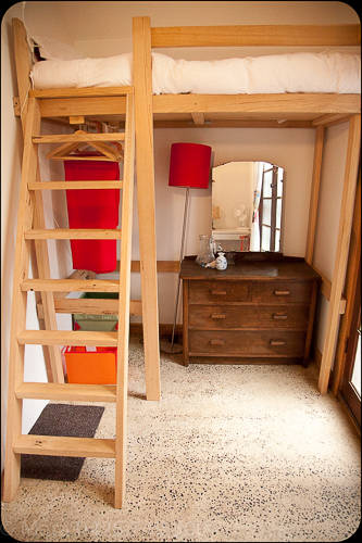 One of the two bungalow bedrooms with loft bed.
