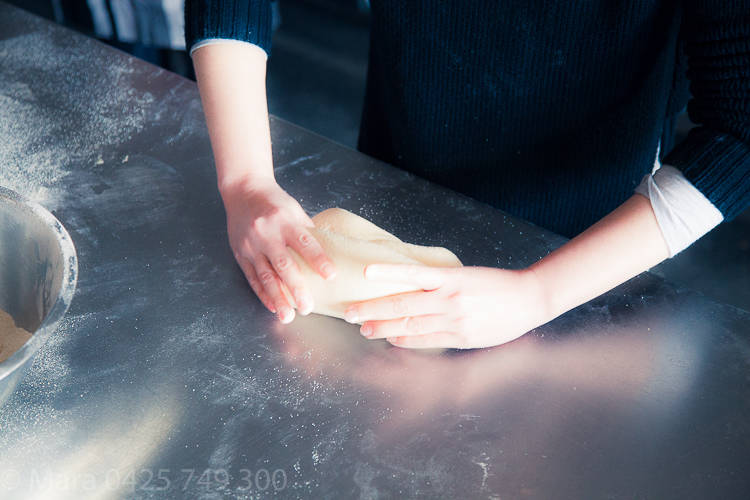 Slow press down with thumbs while dragging, rolling dough forward.