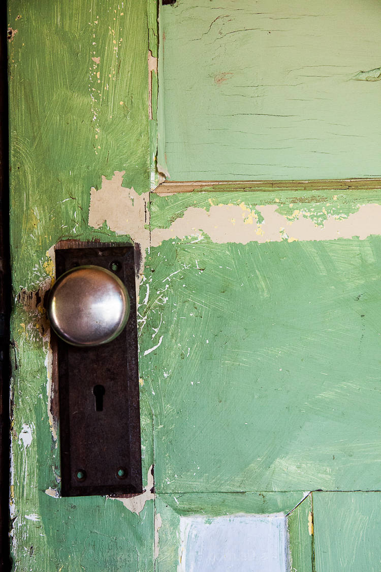 With crackling paint that catches my gaze, and door handles old and not so very shiny. Not as shiny as the new ones in the shop that whisper silence not stories like these.