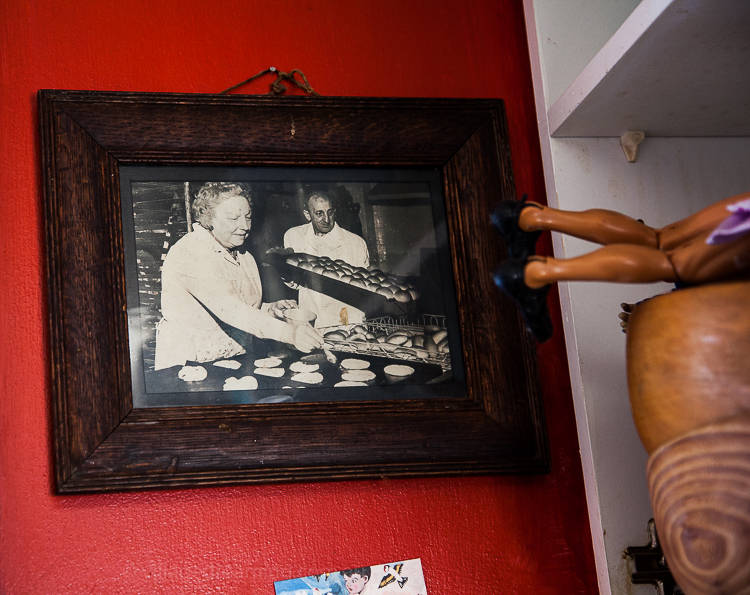 I notice a photograph on the red drenched wall and ask her about it. It depicts an elderly couple making bread in a small commercial bakery. Alison laughs and explains that she and her husband pretend the photo depicts important family members, great bread artisans of the past.