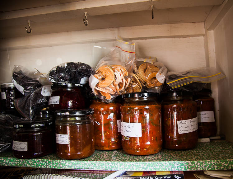 In her cupboard a shelf full of home preserves and dried apples and plums from her trees. Now you must try home grown home dried apples especially those with skin on! They are intensely deeply richly flavoured. They are soooo blooming wonderful!