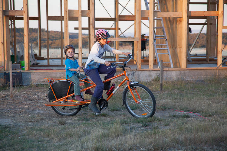 A bike ride in the afternoon sun and in the background the framing of our home goes up.