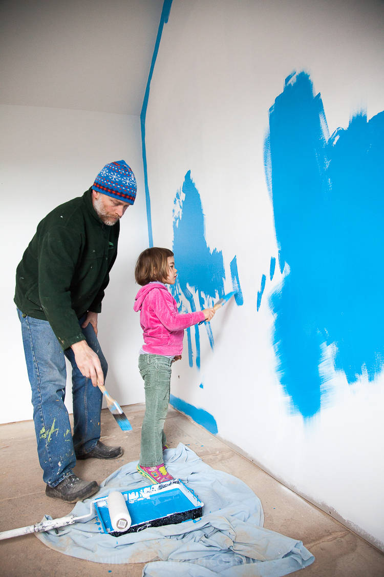 Painting internal walls with low VOC paints.