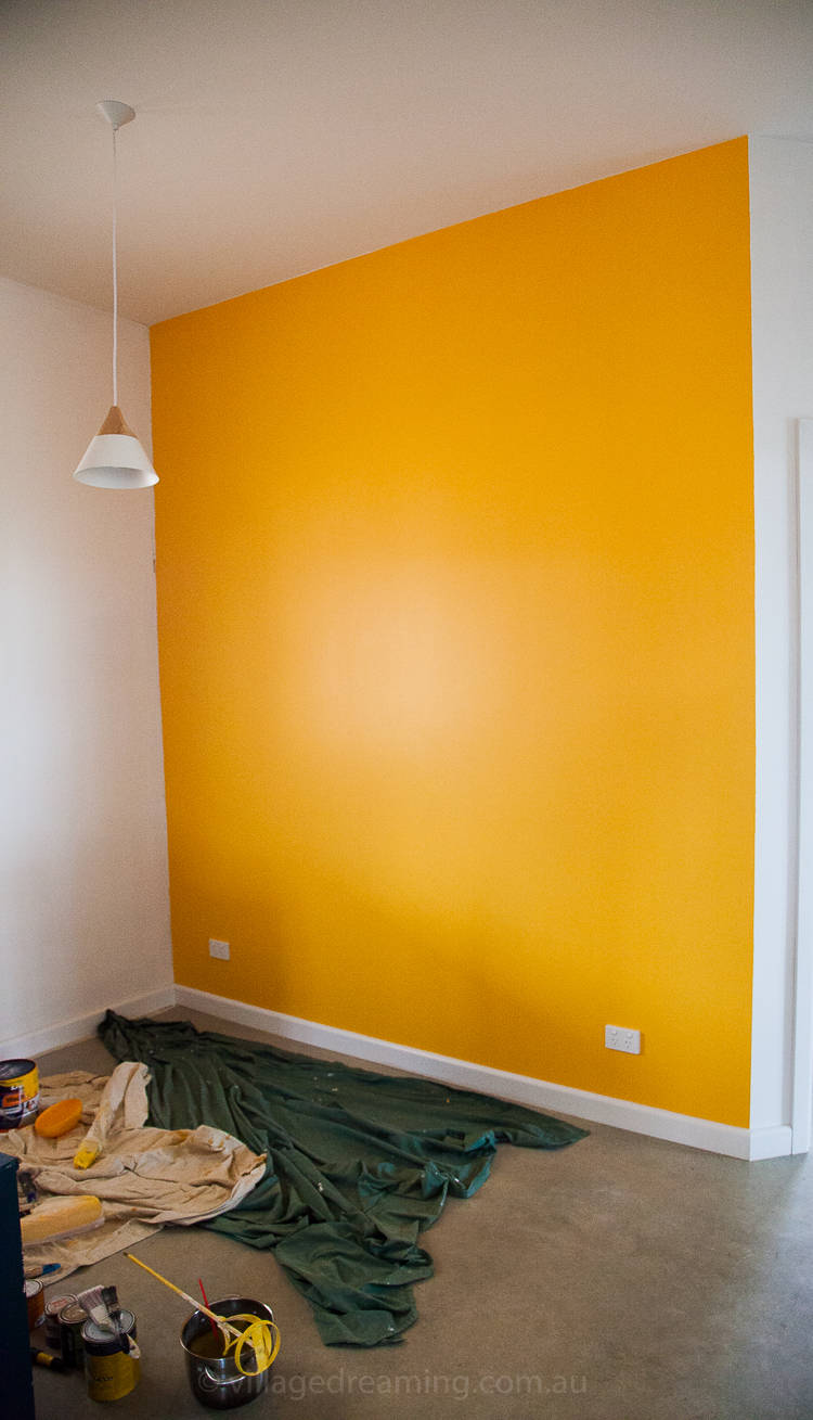 A study wall in deep yellow.