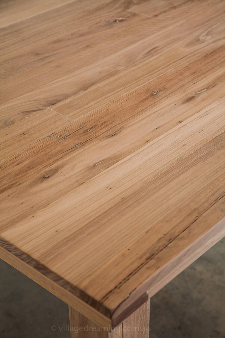 A dining table made from leftover floor boards.